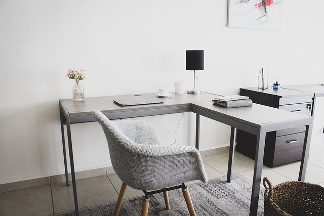 A desk with a chair in a room
